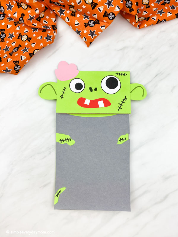 Green paper bag zombie craft