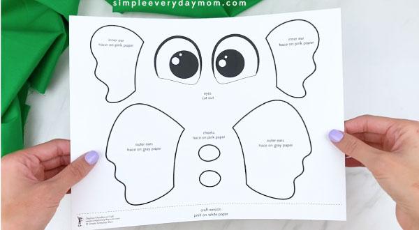 Hands holding elephant headband craft template