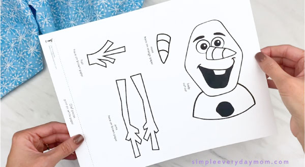 hands holding Olaf craft template