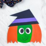 dark green and orange haired paper plate witch