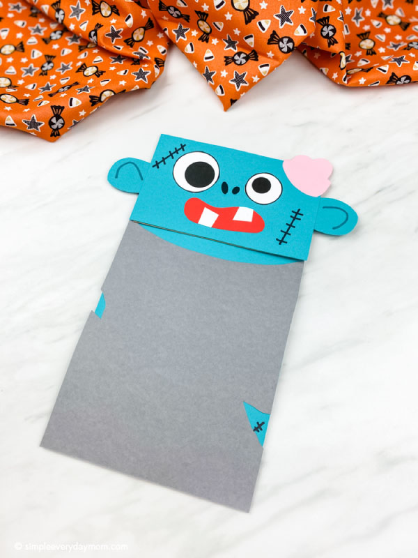Blue paper bag zombie craft