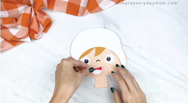 hands gluing mouth to paper pilgrim