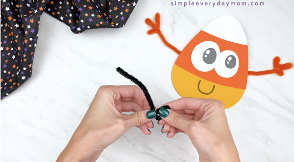 hands bending black pipe cleaner