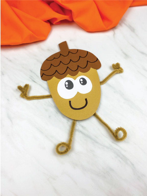 paper acorn craft with brown pipe cleaner arms and legs