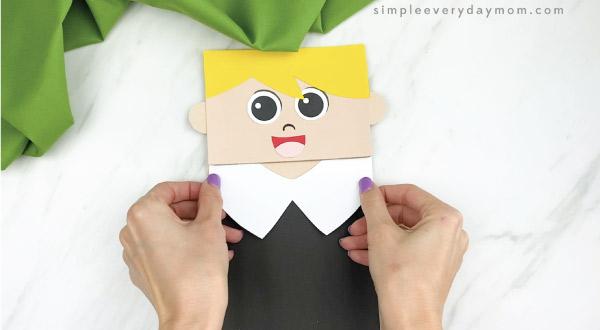 hands gluing pilgrim collar to paper bag pilgrim craft