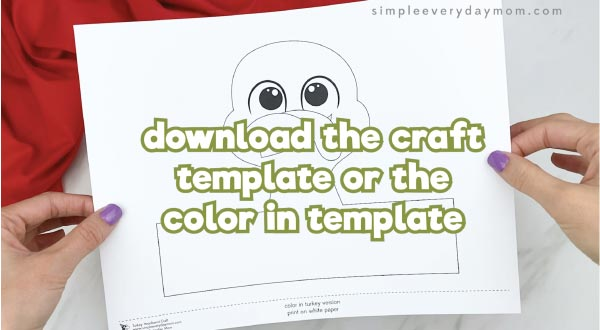 hands holding turkey headband template
