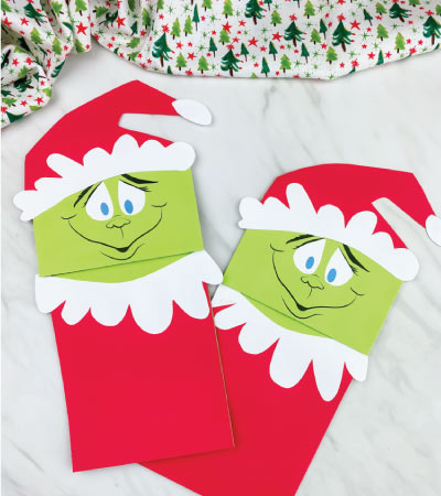 two paper bag grinch crafts