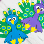 blue and purple handprint peacock crafts