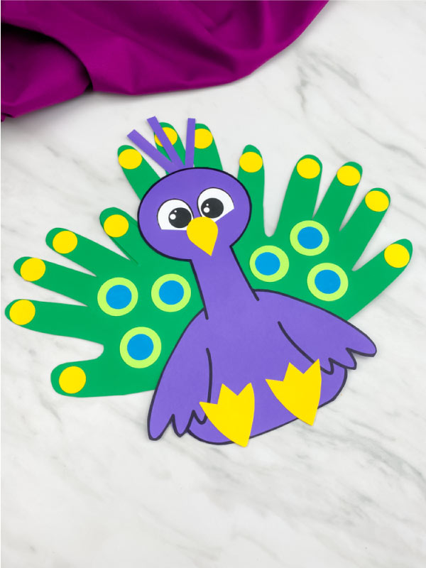 purple handprint peacock craft