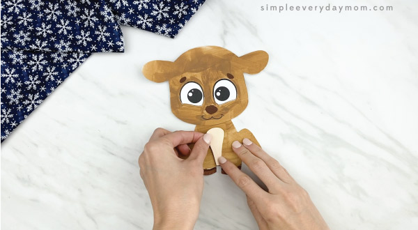 hands gluing belly onto printable reindeer craft