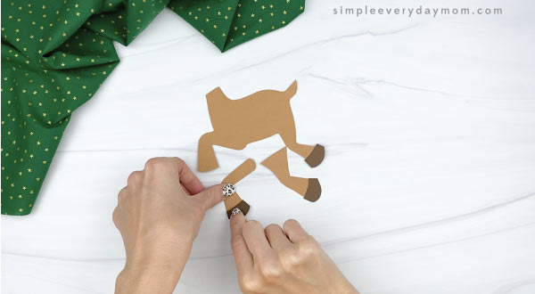 hands ghands gluing hooves to paper rudolph craftluing antlers to paper rudolph craft