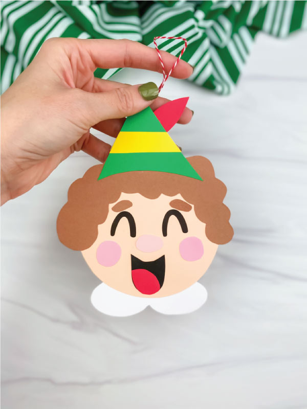 hand holding elf ornament craft