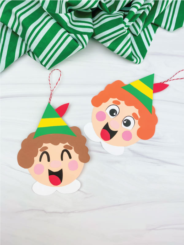 orange haired and brown hair elf ornament craft