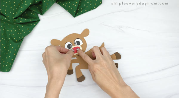hands gluing nose to paper rudolph craft