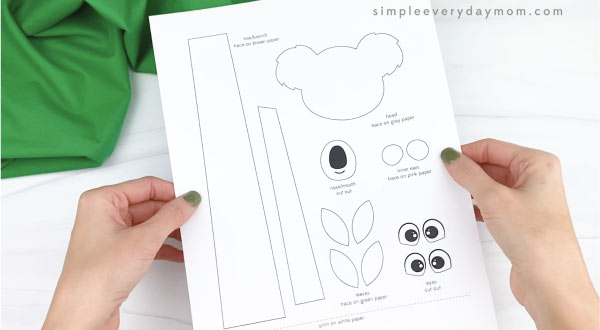 hands holding handprint koala craft template