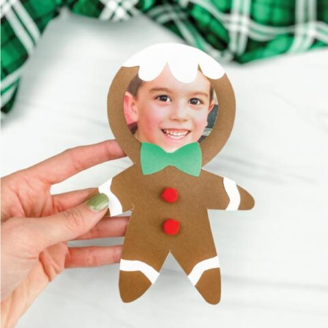 hand holding photo gingerbread man craft