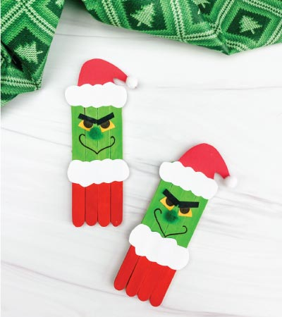 two popsicle stick grinch crafts