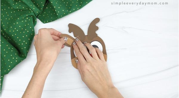 hand gluing ear to reindeer Christmas card