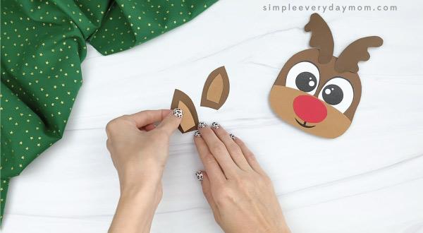 hand gluing inner ear to outer ear of reindeer Christmas card