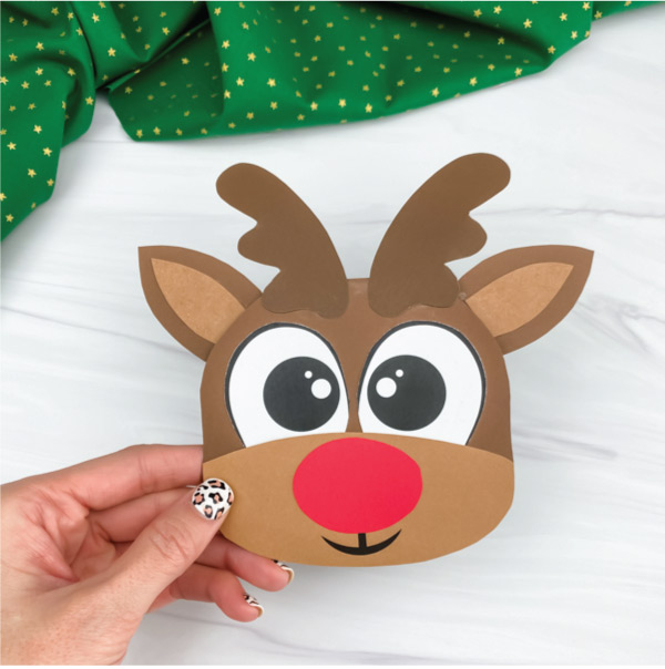 hand holding reindeer Christmas card