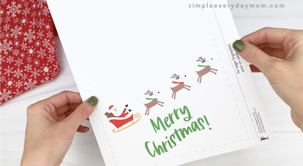 hands holding reindeer fingerprint christmas card template