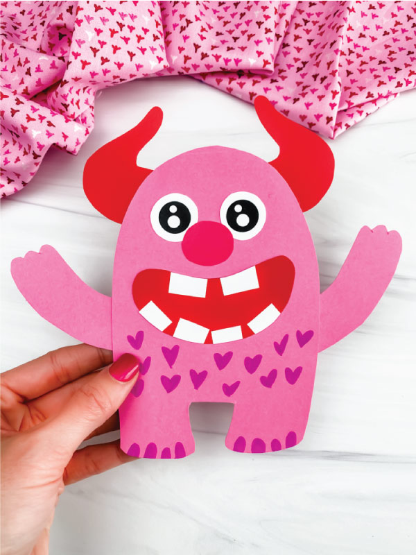 hand holding love monster craft