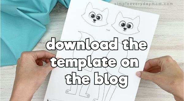 hands holding popsicle stick arctic fox craft template