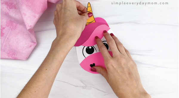 hand gluing horn onto unicorn card craft