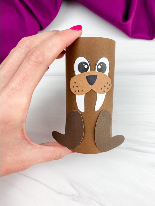 hand holding toilet paper roll walrus craft
