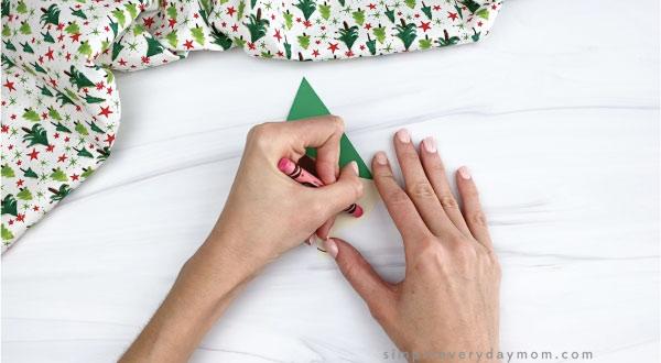 hands drawing cheeks onto paper elf craft