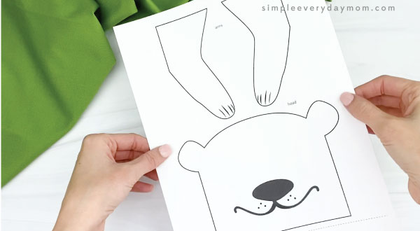 hands holding paper bag groundhog craft template