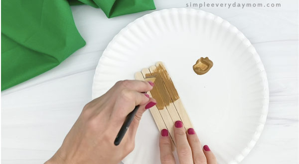 hand painting popsicle sticks brown