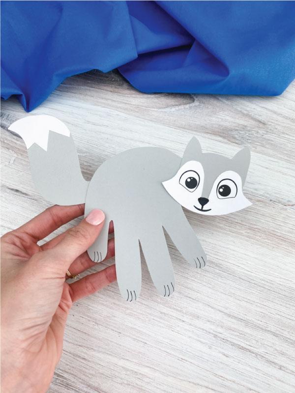 hand holding handprint arctic fox