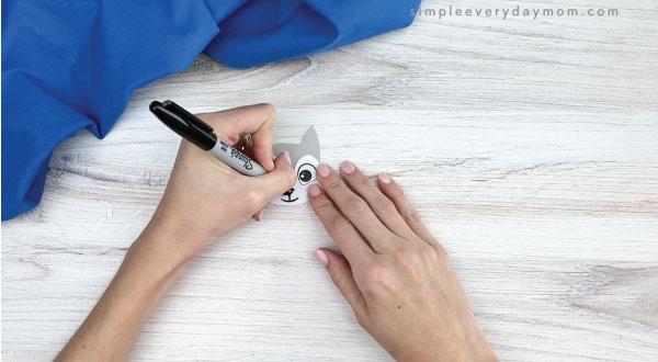 hand drawing nose on to handprint arctic fox