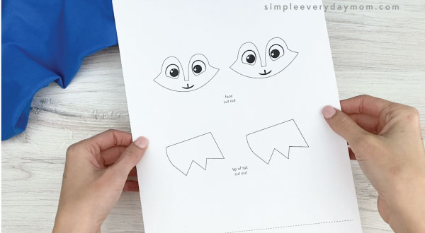 hand holding handprint arctic fox craft template