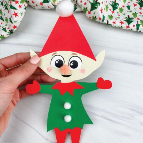 hand holding paper elf craft