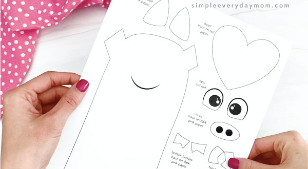 hand holding pig valentine craft template