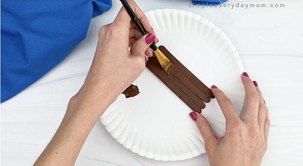 hand painting popsicle sticks dark brown