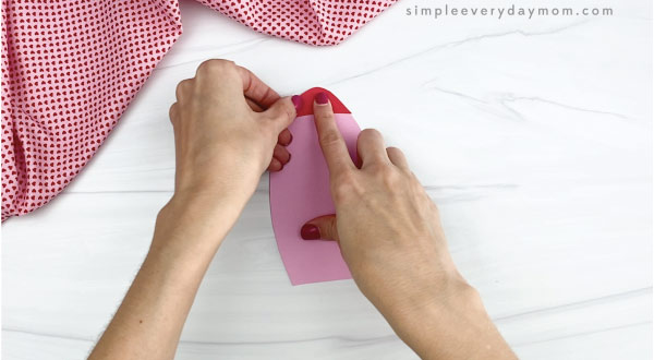 hands gluing tip to rocket valentine craft