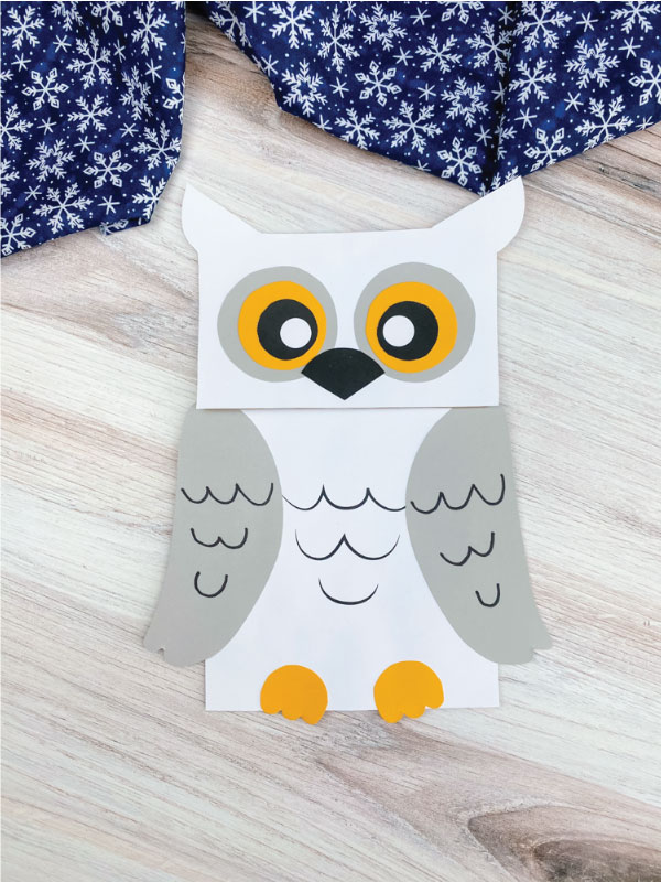 white and gray paper bag snowy owl