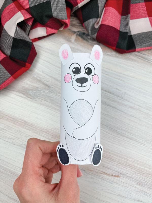 hand holding toilet paper roll polar bear craft