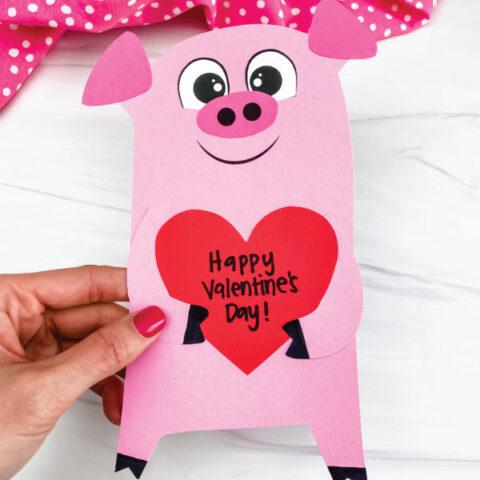 hand holding valentine pig craft