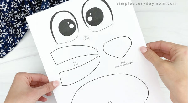 hands holding paper plate walrus craft template