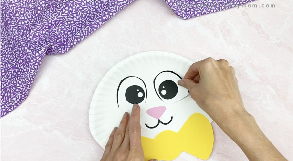 hand gluing eyes to paper plate Easter bunny craft