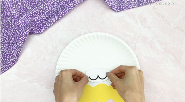 hand gluing mouth to paper plate Easter bunny craft