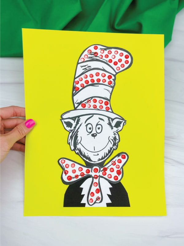 hand holding cat in the hat craft