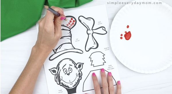 hand painting dots on cat in the hat craft with back of pencil eraser