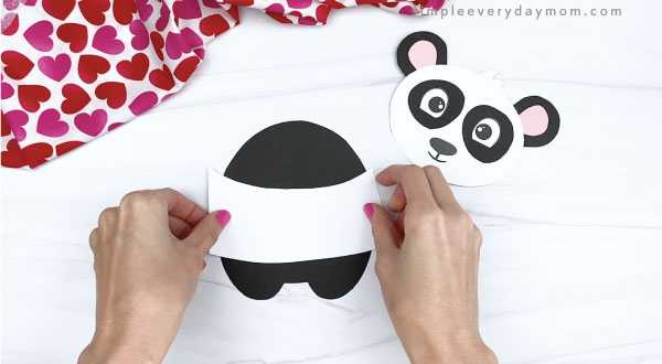 hand gluing belly stripe to panda valentine craft