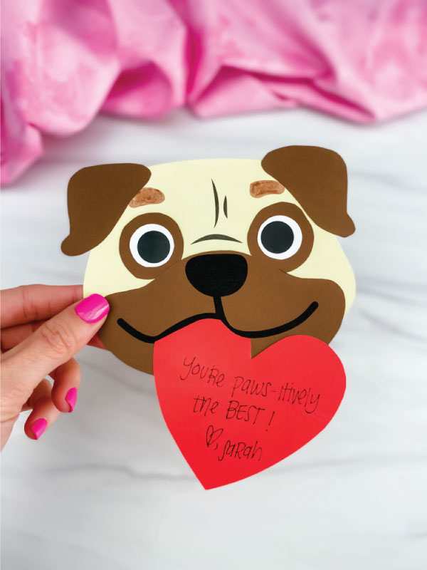 hand holding puppy valentine craft