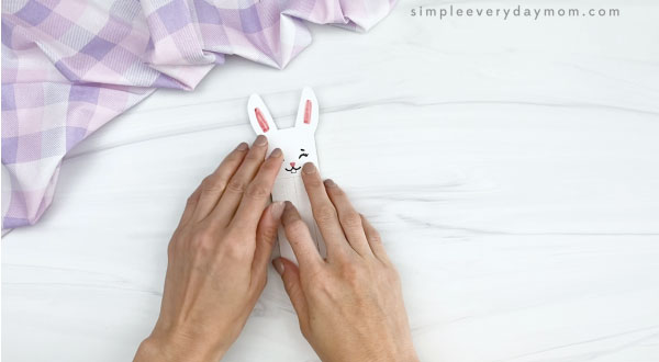 hand gluing head to popsicle stick easter bunny craft